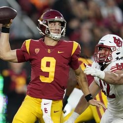 Southern California quarterback Kedon Slovis throws under pressure from Utah defensive end Mika Tafua (42) during the first half of an NCAA college football game Saturday, Oct. 9, 2021, in Los Angeles.