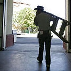 Joe Ruth carries a ladder through the Promontory building as he works to get the Fairpark ready for his 32nd Utah State Fair.