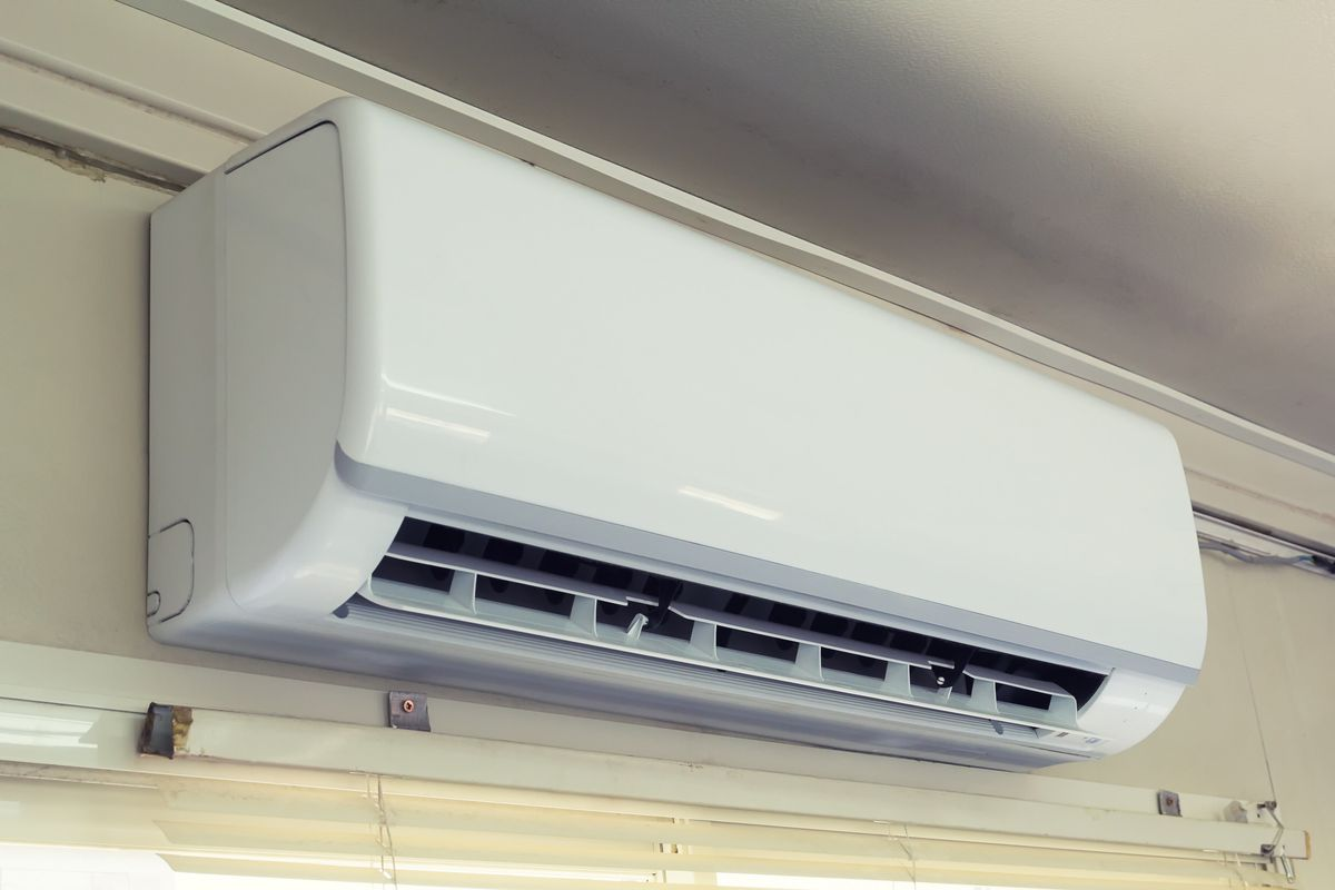 A white ductless mini split which can be used for AC in the interior of a home, just below the ceiling.