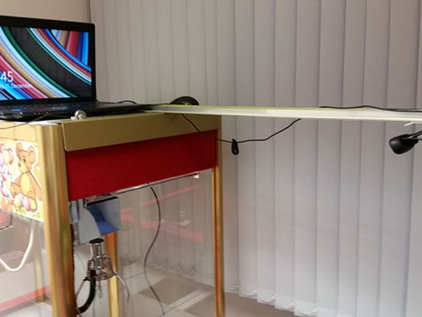 This crane machine is hooked up to a Raspberry Pi so you can play it