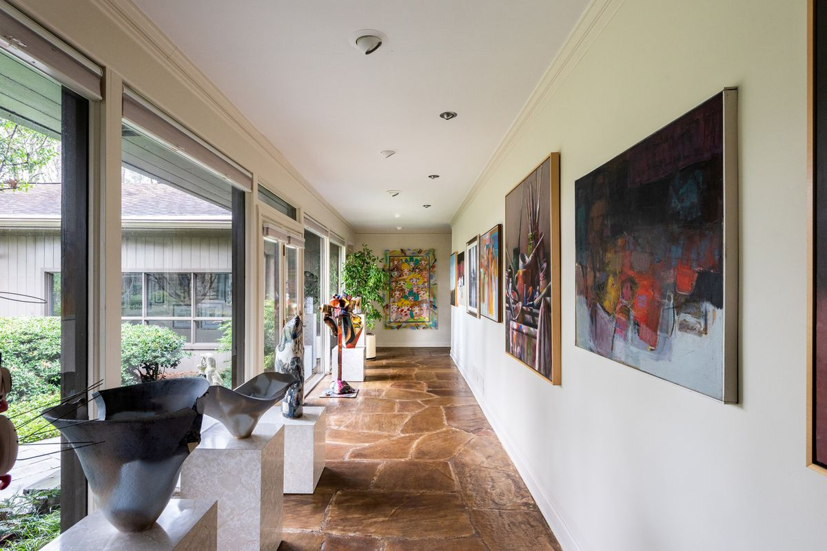 A long corridor with colorful art on the walls.