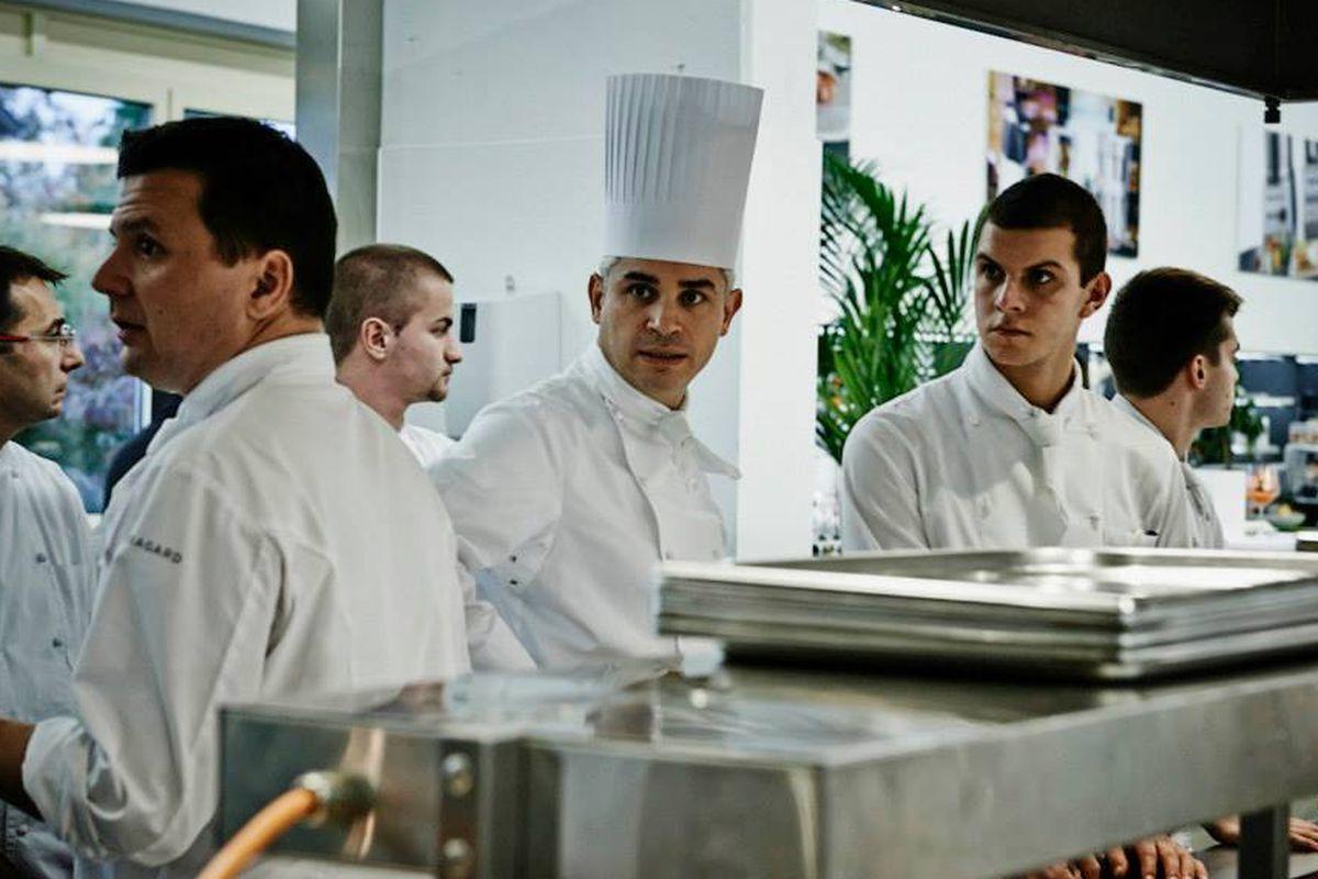 Chef Benoît Violier with staff at Restaurant de l'Hôtel de Ville in Crissier, Switzerland