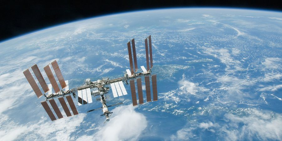SpaceX will send three tourists to the International Space Station next year