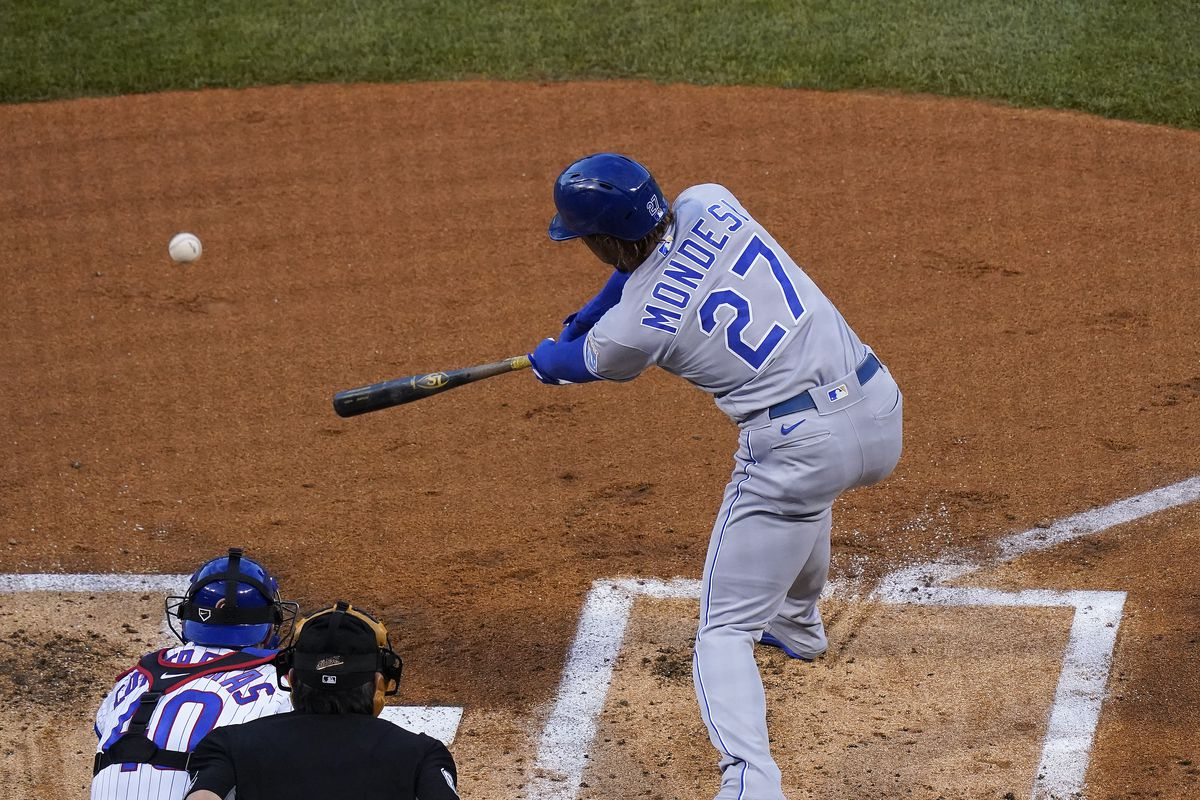 Adalberto Mondesi follows through in the process of hitting an RBI single against the Cubs.