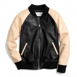 "<a href=""http://f.curbed.cc/f/Coach_031014_Varsity"">Leather Varsity Jacket in Black/Vachetta</a>, $1,098"