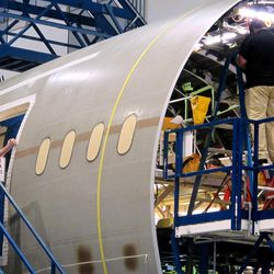 Workers assemble the aft section of Boeing's new 787 aircraft at the company's plant in North Charleston, S.C., on Friday, April 27, 2012. The company was rolling out the first of its new 787s manufactured at its South Carolina plant which opened last year.