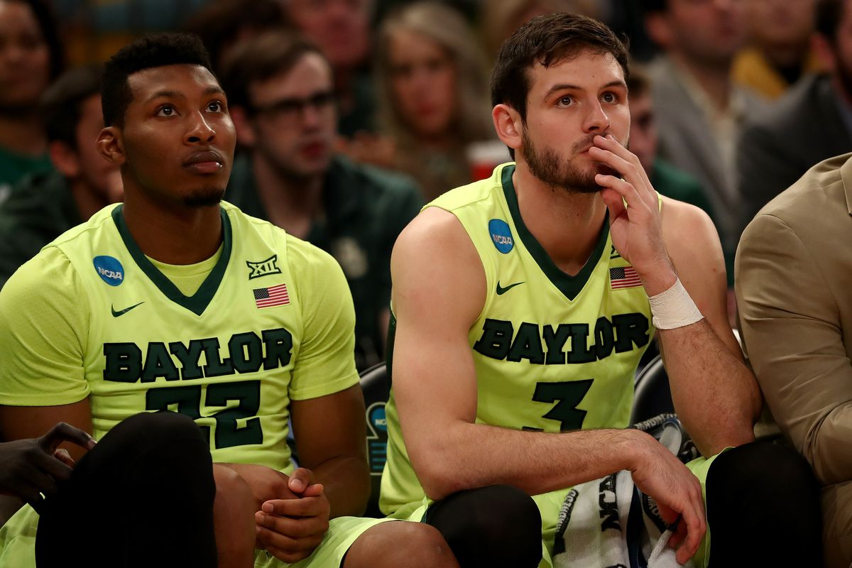 NEW YORK, NY - MARCH 24:  King McClure #22 and Jake Lindsey #3 of the Baylor Bears look on from the bench in the second half against the South Carolina Gamecocks during the 2017 NCAA Men's Basketball Tournament East Regional at Madison Square Garden on March 24, 2017 in New York City.  (Photo by Elsa/Getty Images)