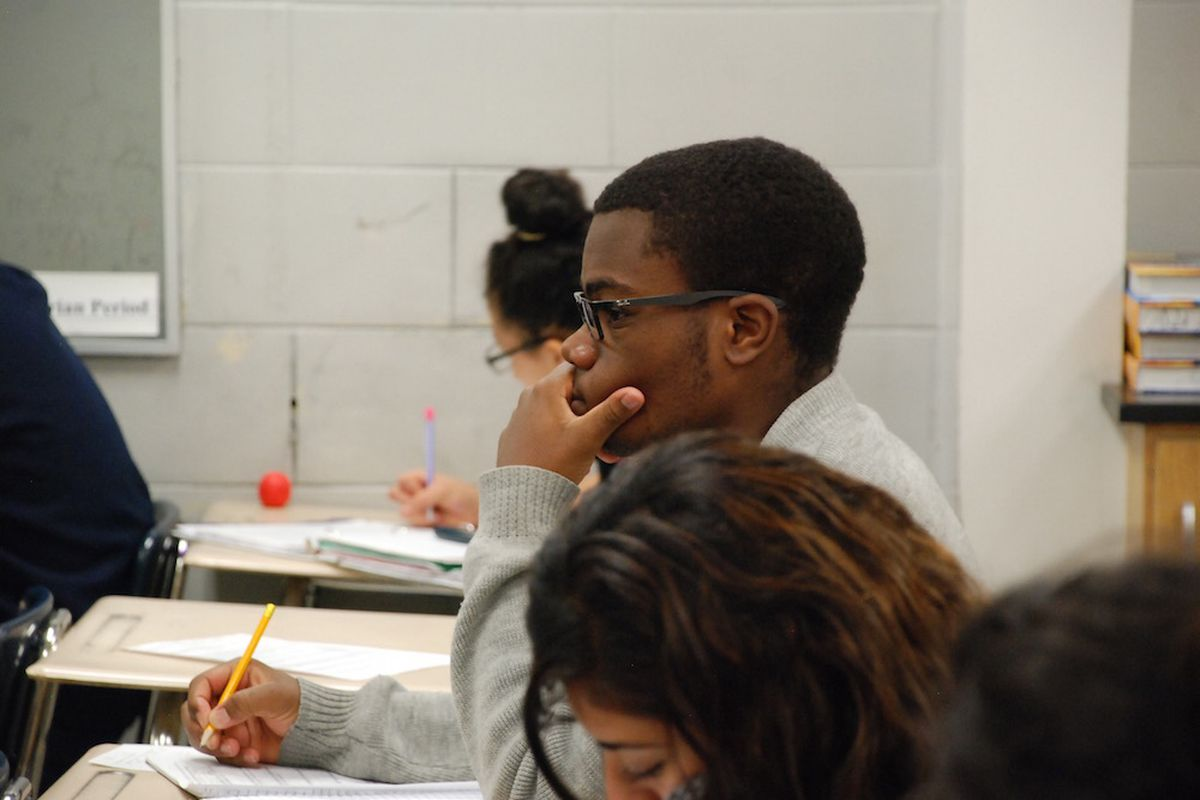 An Aurora Central High School student listens during his advanced science class in 2015.