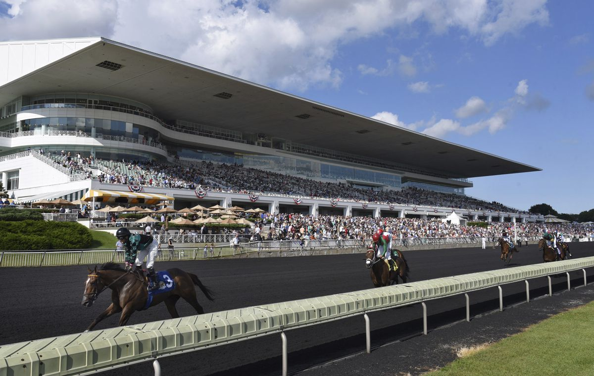 Horses in the Bruce D. Memorial Stakes pass the grandstand at Arlington International Racecourse in Arlington Heights in 2017.