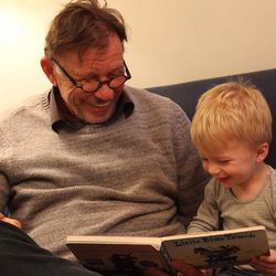 Richard Eyre reads with one of his grandchildren.