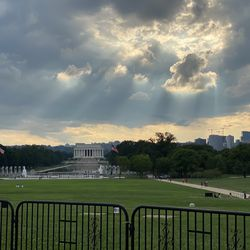 Nice rays of sun shining through the clouds as you look out from the foot of the Washington Monument toward the Lincoln Memorial.