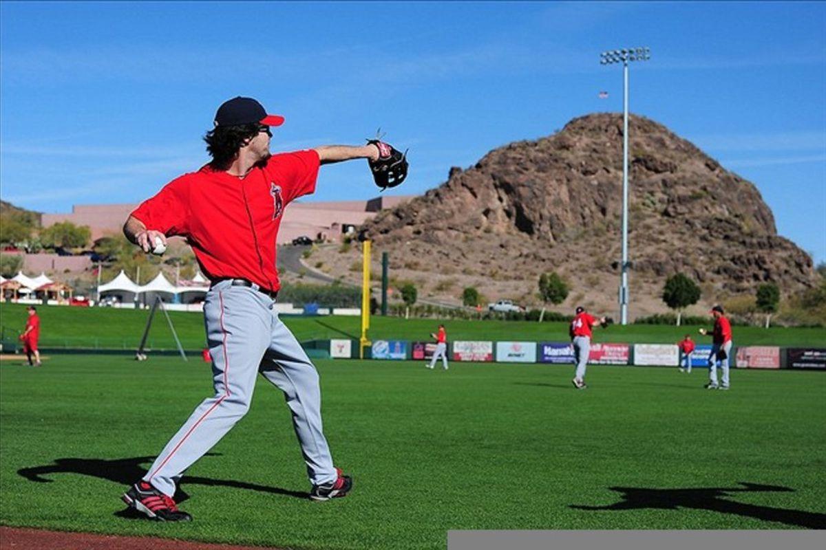 February 26, 2012; Tempe, AZ, USA; Los Angeles Angels starting pitcher Dan Haren (24) throws the baseball during spring training at Tempe Diablo Stadium. Mandatory Credit: Kyle Terada-US PRESSWIRE