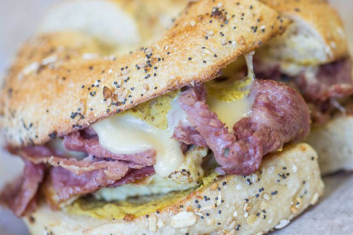 At New Orleans' Stein's Market & Deli, this scrambled egg sandwich is made with Swiss cheese, spicy brown mustard, and either corned beef or pastrami.