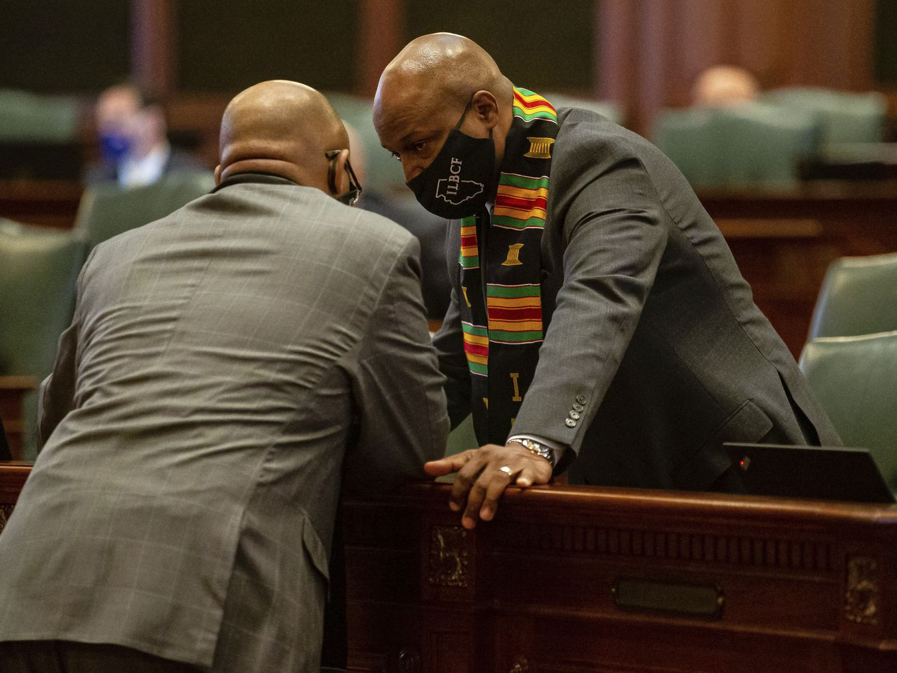 "Illinois Speaker of the House Emanuel ""Chris"" Welch, D-Hillside, talks with Illinois State Rep. Will Davis, D-Homewood, during session on the floor of the Illinois House."