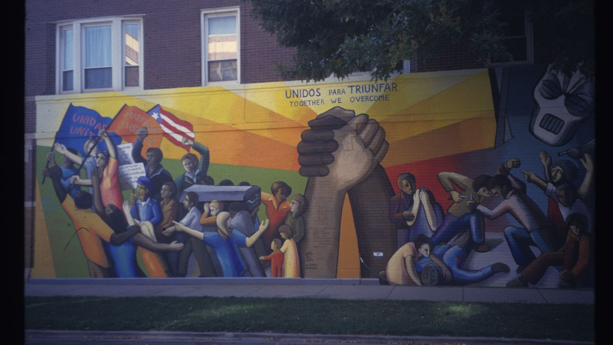 """This mural, titled """"Together We Overcome,"""" was completed by John Pitman Weber at Division and Hoyne in 1971. Restored in 2004, it's one of the oldest murals in Chicago — and the country."""