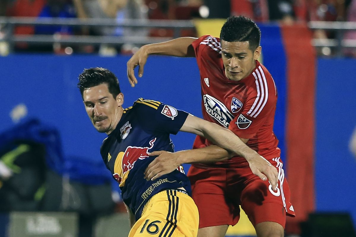 Sacha Kljestan shields the ball from FC Dallas
