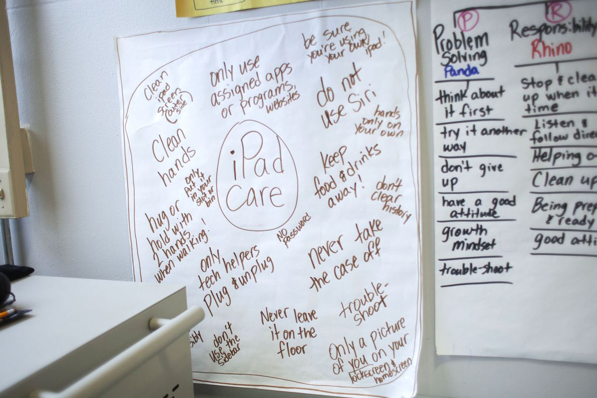 A sign on a classroom wall last year at CICS West Belden instructed students on iPad care. The Chicago charter network employs technology for its personalized learning model and has transitioned to virtual learning during the 2020 school shutdown.