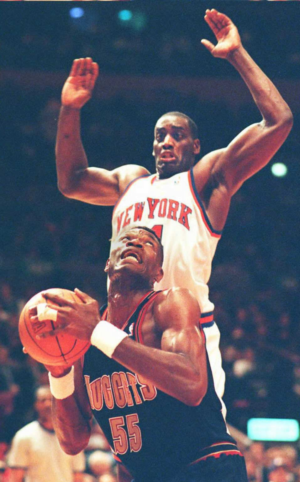 Denver Nuggets Dikembe Mutombo looks up to the bas
