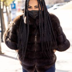 """""""The Real Housewives of Salt Lake City"""" star Jen Shah leaves the U.S. District Court in Salt Lake City on Tuesday, March 30, 2021. Shah, who is married to an assistant football coach at the University of Utah, faces federal fraud charges in New York."""