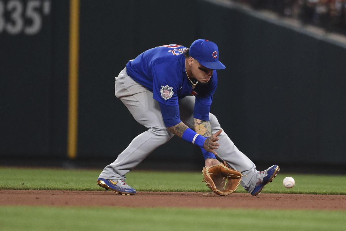 Cubs shortstop Javier Baez fields a ground ball by St. Louis Cardinals' Tommy Edman during the fifth inning of Monday's game.