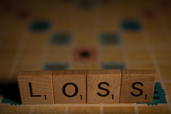 """The word """"loss"""" spelled out in Scrabble tiles"""