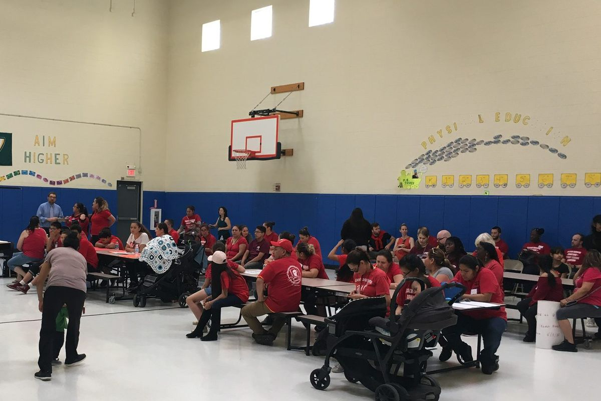 Parents filled the school gym last month to advocate a new teacher contract and protest administrator turnover.