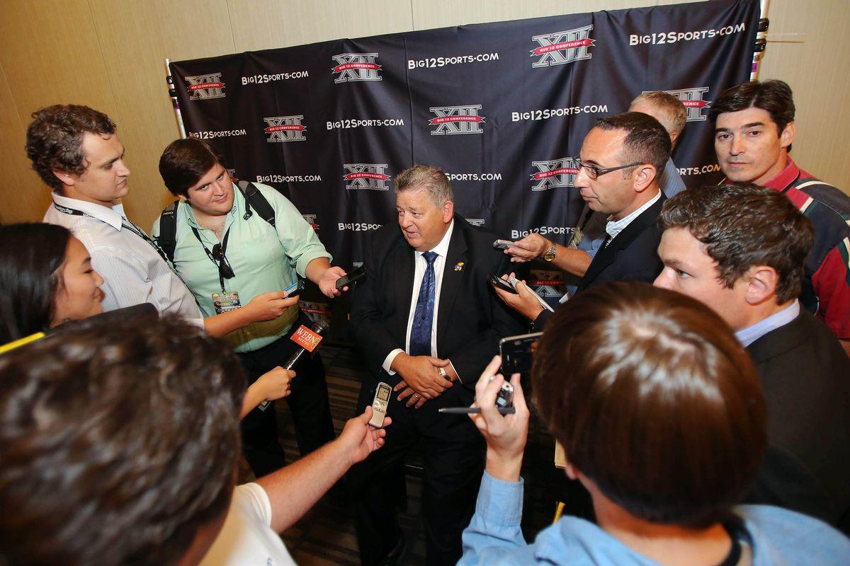 Jul 24, 2012; Dallas, TX, USA; Kansas Jayhawks head coach Charlie Weis speaks to reporters during Big 12 Media Day at the Westin Galleria.  Mandatory Credit: Kevin Jairaj-US PRESSWIRE
