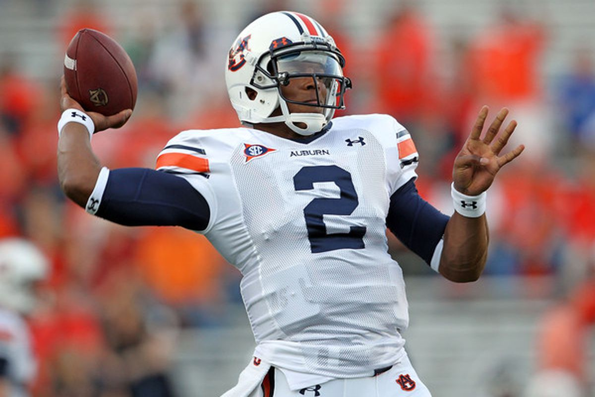 LEXINGTON, KY - OCTOBER 09: Cam Newton #2 of the Auburn Tigers throws a pass as he warms up before the SEC game against the Kentucky Wildcats at Commonwealth Stadium on October 9, 2010 in Lexington, Kentucky.  (Photo by Andy Lyons/Getty Images)