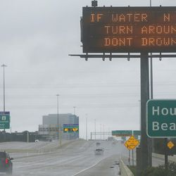 Motorists drive on I-10 during Tropical Storm Harvey in Houston on Tuesday, Aug. 29, 2017.