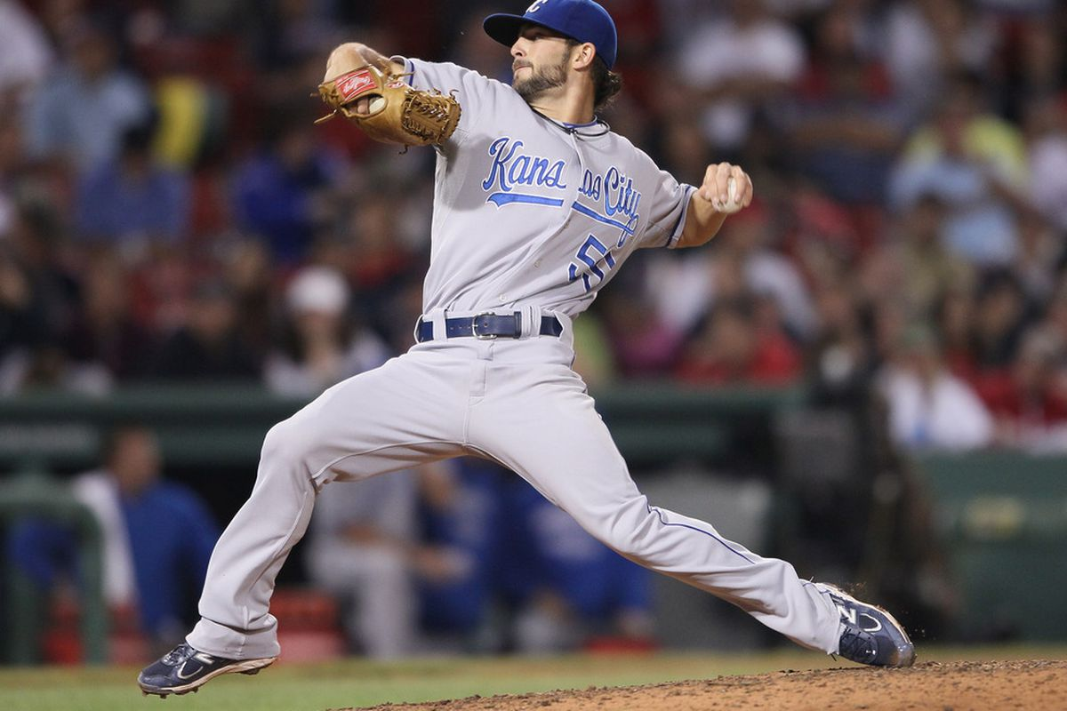 BOSTON, MA - JULY 25:  Tim Collins #55 of the Kansas City Royals delivers a pitch in the seventh inning against the Boston Red Sox on July 25, 2011 at Fenway Park in Boston, Massachusetts.  (Photo by Elsa/Getty Images)