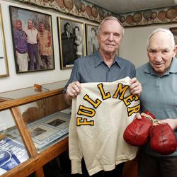 Former middleweight boxing champion Gene Fullmer, right, and Bill Jenson, son of the late legendary boxing manager Marv Jenson, stand in the West Jordan History Museum.