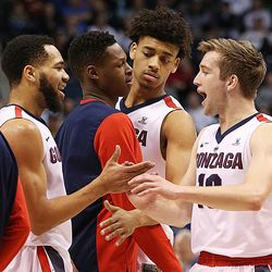 Gonzaga Bulldogs guard Silas Melson (0) celebrates with teammate Gonzaga Bulldogs guard Jesse Wade (10) as BYU and Gonzaga play in an NCAA basketball game in the Marriott Center in Provo on Saturday, Feb. 24, 2018.