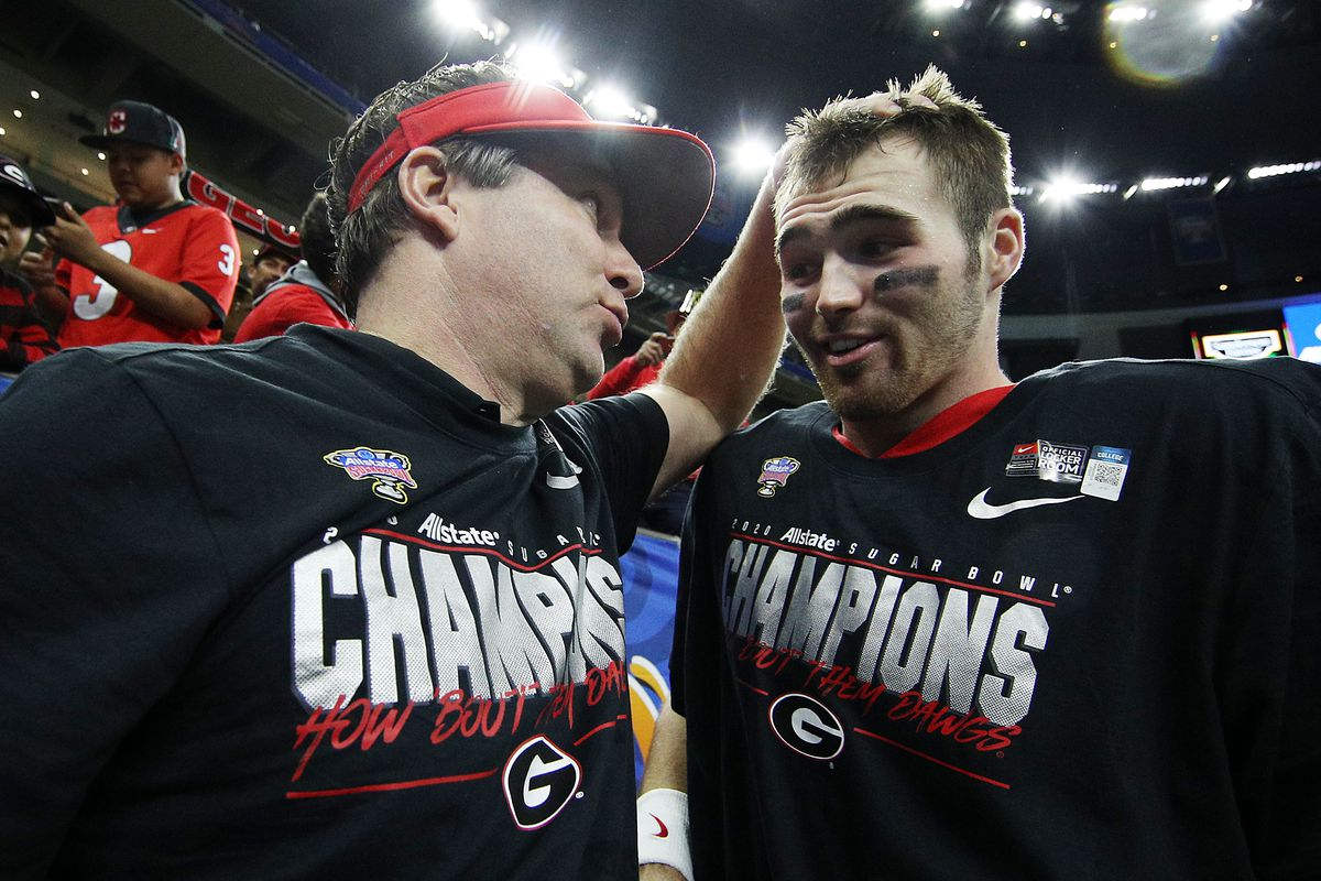 Head coach Kirby Smart of the Georgia Bulldogs celebrates with Jake Fromm of the Georgia Bulldogs after defeating the Baylor Bears 26-14 during the Allstate Sugar Bowl at Mercedes Benz Superdome on January 01, 2020 in New Orleans, Louisiana.