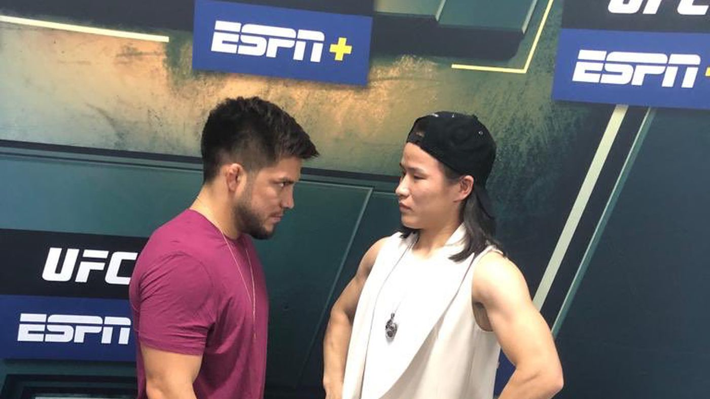 Henry Cejudo dwarfed by Weili Zhang during staredown with 'so-called female champ'