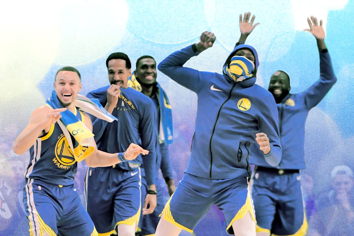 The Warriors smiling and cheering