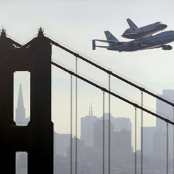 Space Shuttle Endeavour mounted on NASA's Shuttle Carrier Aircraft,  passes over the Golden Gate Bridge in San Francisco,  Friday, Sept. 21, 2012.  Endeavour is making a final trek across the country to the California Science Center in Los Angeles, where it will be permanently displayed.