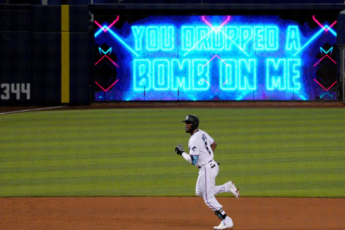 Starling Marte #6 of the Miami Marlins runs the bases after hitting a solo home run in the second inning against the Colorado Rockies at loanDepot park
