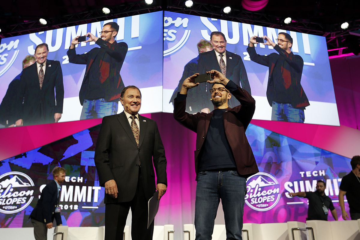 Gov. Gary Herbert, left, and Pluralsight CEO Aaron Skonnard participate in the Silicon Slopes Tech Summit at the Salt Palace in Salt Lake City on Friday, Jan. 19, 2018.