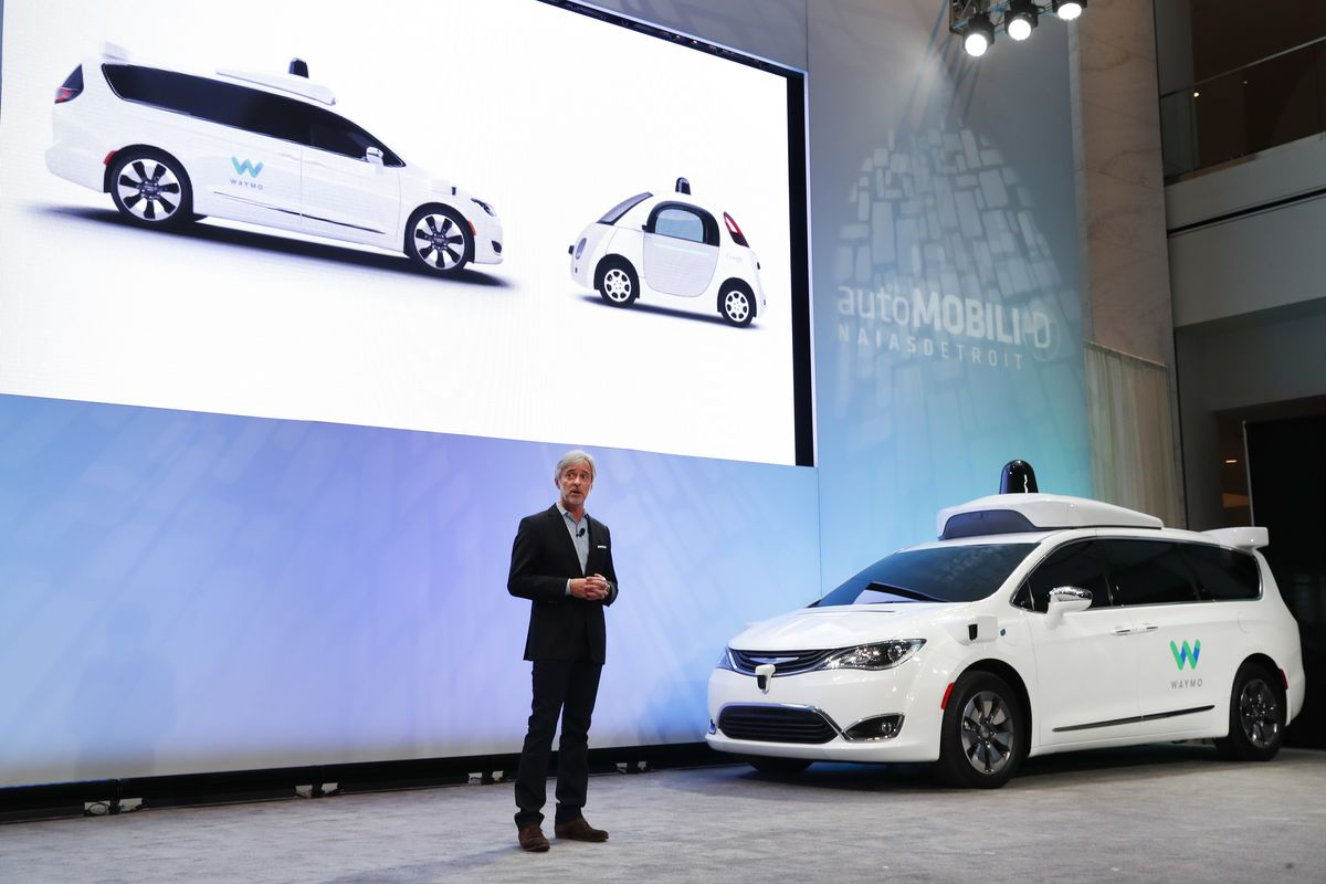 FILE - In this Jan. 8, 2017, file photo John Krafcik, CEO of Waymo Inc., the autonomous vehicle company created by Google's parent company, introduces a Chrysler Pacifica hybrid outfitted with Waymo's own suite of sensors and radar at the North American I