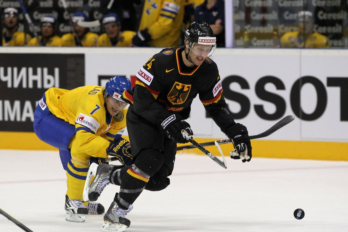 David Rundblad chases a German player. (Photo by Martin Rose/Bongarts/Getty Images)