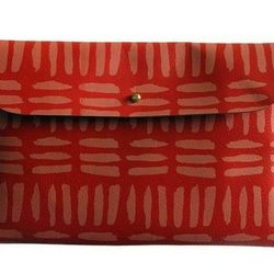 """<b>Falconwright</b> Clutch in coral with brush strokes, <a href=""""http://dalaganyc.com/collections/accessories/products/coral-w-brush-strokes-clutch#"""">$65</a> at Dalaga"""