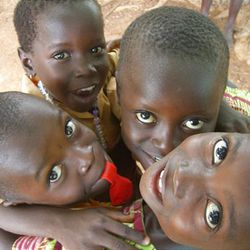 Children in Ghana mug for the camera. Empowering Nations volunteers have taught English there.