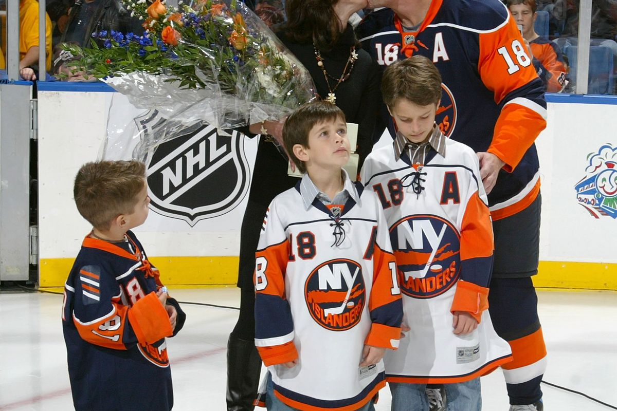 Mike Sillinger #18 of the New York Islanders kisses his wife Karla as their three sons Owen, Lukas and Cole look on as Mike is honored on playing his 1000th NHL game prior to the game against the Tampa Bay Lightning on November 1, 2007 at Nassau Coliseum in Uniondale, New York