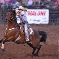 Morgan Jensen races towards the third barrel during the Utah High School Rodeo Finals in Heber City on Saturday, June 3, 2017.