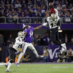 New Orleans Saints free safety Marcus Williams (43) intercepts a pass intended for Minnesota Vikings wide receiver Stefon Riggs (14) during the second half of an NFL divisional football playoff game in Minneapolis, Sunday, Jan. 14, 2018. (AP Photo/Jeff Roberson)