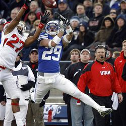 BYU wide receiver Luke Ashworth (29) goes up for a catch attempt over Utah defensive back Brandon Burton during their game at LaVell Edwards Stadium in Provo Saturday. BYU won 26-23 in overtime.