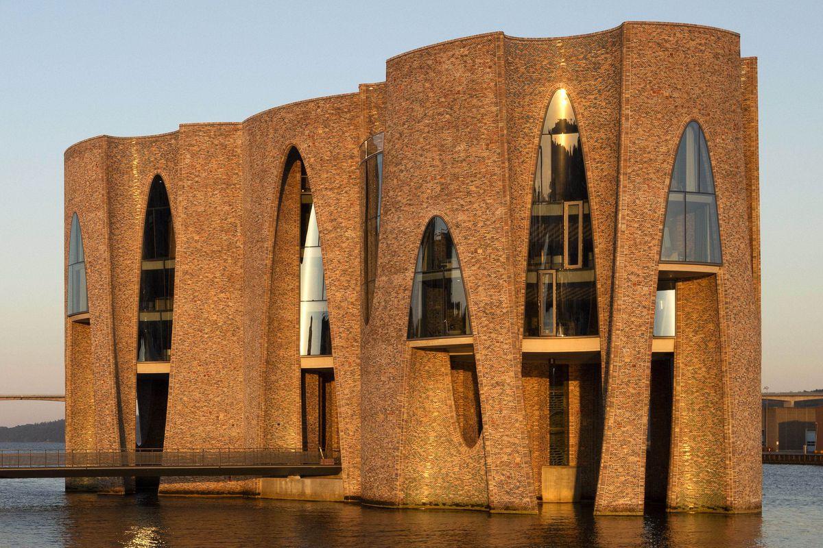 Brick building in harbor at golden hour