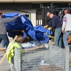 5:13 p.m. The Ernie Banks statue being unwrapped -