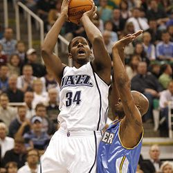 Utah's C.J. Miles shoots over Denver's Chauncey Billups as the Utah Jazz and the Denver Nuggets play in game 3 of the first round of the NBA basketball playoffs.