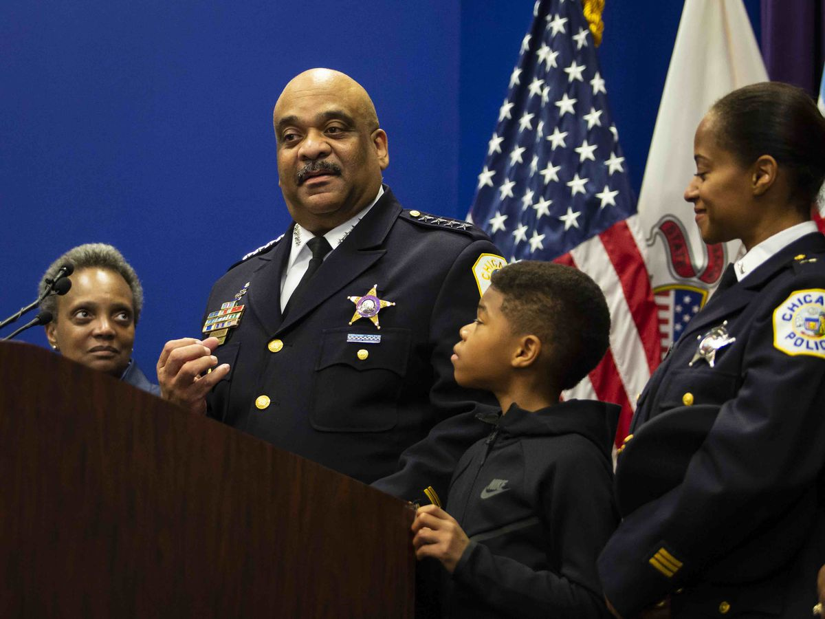 With Mayor Lori Lightfoot, his 10-year-old son and his wife looking on, Chicago Police Supt. Eddie Johnson announced his retirement Thursday, Nov. 7, 2019.